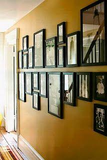 I've always wanted a photo wall, and I loooooooove the line through the center.