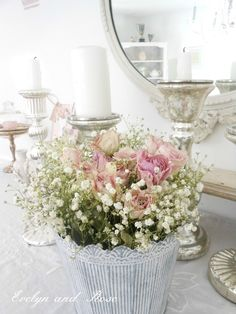 Love the flower arrangement, the mercury glass candlesticks, the mirror, love it all~❥