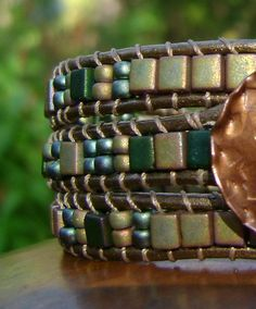 Wrap Bracelet leather and Miyuki Cubes and Seed Beads, Handmade Copper Button. $40.00, via Etsy.