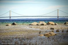 View of the Mighty Mackinac bridge from the shore near McGulpin Point Lighthouse.