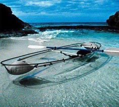 A paddle in a glass boat over a reef full of fish. / http://www.bermuda-attractions.com/bermuda_0001df.htm