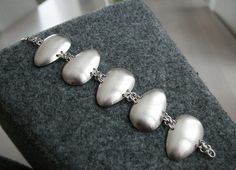 Silver spoon bracelet by Vilman, via Flickr