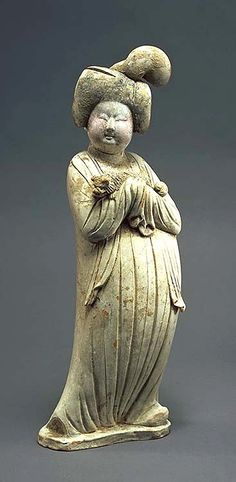 Tang Dynasty Beauty Holding a Pekinese lap dog. 8th C. tomb figurine, terra cotta with pigments. 19 in.