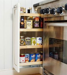 """I small cabinet on the right! """"Cozy Kitchen Cozy Kitchen  Practical Pullouts  In a narrow space between the wall and range, a handy pullout shelf stores oils, canned goods, and more."""""""