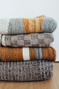 SCARF/ Blanket stack in neutral patterns and textures.