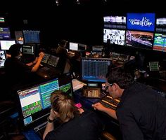 Six technical directors run Disney's World of Color from a command center that can adjust color intensity, fountain movements, and other show elements using 18,000 points of control.
