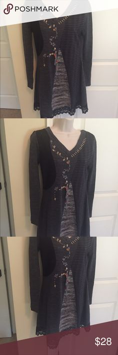 Super cute mixed media sweater dress size S Moka sport mixed media A line sweater dress size S. 80 acrylic, 10 mohair, 10 cotton. Lace 100 percent cotton. Looks super cute with boots. Asymmetrical lace hem- flattering shape. Very unique piece. Laying flat, measuring from pit to pit is approx. 17.5in. Shoulder to hem is approx. 34in. Moka Sport Dresses Mini