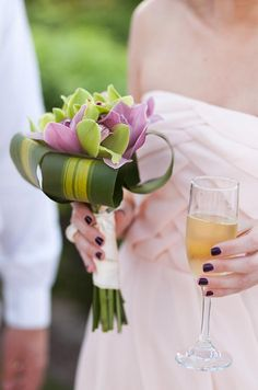 ♥ Check out these Bridesmaids' bouquets in bright, tropical hues that pop against their soft pink dresses.