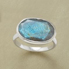 SWEETWATER RING -- Labradorite is set in a sterling silver bezel upon a sterling silver band. Exclusive. Whole sizes 5 to 10. This ring is running slightly large, half sizes should size down to the lower whole size.
