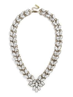 A vintage-inspired crystal necklace adds a sophisticated touch to any outfit, with a ombré gemstones at the center to anchor this timeless statement.%0D%0A