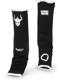 """Warrior Slip-On Shin/Instep Guards, BK/WH, REG by Warrior. $24.99. Super stretch poly and spandex blend is designed for simple, efficient and quick application for athletes on the go. Tough elasticized cover keeps guards firmly intact and secure during intense action. More than 1"""" of multi-layer contoured shock absorbing foams expertly covers the shin, ankle and instep with incredible results. Fully machine washable for maximum results. An ideal choice for combatant..."""