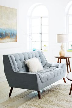 west elm powder blue tufted sofa and cream shag rug with mid century table lamp