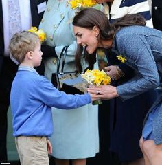 Catherine receiving flowers on St. David's Day 3/2/12. #Kate #Middleton