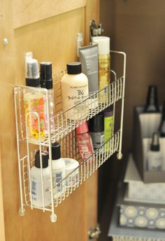 Bathroom Organization - Ta-Da!  Love love love this idea!  This is going to revolutionize the way I clean my bathroom vanity!  Spice rack inside the bathroom cabinet - who knew?!?