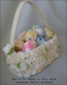 Papier mache Easter basket with felt flower rosettes. Soft Easter eggs made with vintage bed linens.
