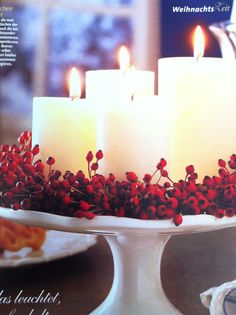 Love pillar candles grouped like this. You could put pink and purple ribbons around them as an advent wreath and then switch to a berry wreath and greenery or red ribbons at Christmas. IKEA have great pillar candles Merry Little Christmas, Noel Christmas, Winter Christmas, Christmas Crafts, Thanksgiving Holiday, Christmas Ideas, Decoration Christmas, Christmas Centerpieces, Xmas Decorations