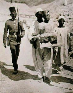 Picture taken in 1922 while transporting one of the contents found inside the tomb of king Tut, #Luxor, #Egypt.