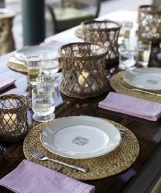 seersucker napkins, high gloss wood table, and wicker/cane candle holders!