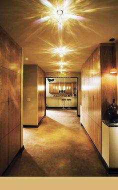 prismatic lighting in large hallway, drop pendant lighting, dramatic lighting flares