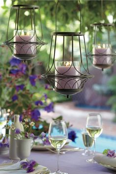 Garden Sanctuary Hanging Lantern and GloLite by PartyLite™ Jar Candle in Geranium Citronella™, available April 1.