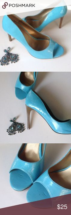 """CHARLOTTE RUSSE BLUE PATENT PEEP TOE PUMPS Blue/teal peep toe pumps with wooden stacked approximate 4"""" heel. The soles & lifts are in very good condition with several indentations on the patent due to storage. You can see in the toe area where they have been stored on a rack!  These flaws do not detract how nice the shoes look with the right styling. Im pretty sure I have never seen anyone close to my feet looking at my shoes for flaws! Size 10. These were purchased for an Ovarian Cancer…"""