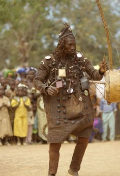 Africa | A Bamana hunter-griot (bard) performing a dance in Narena, Mali. February of 1995.