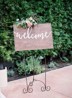 Elegant wooden welcome wedding sign: http://www.stylemepretty.com/california-weddings/san-juan-capistrano/2016/09/23/old-world-elegance-meets-garden-romance/ Photography: Sposto - http://spostophotography.com/