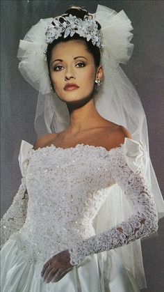 """Demetrios Headpieces 1995     A precious Headpiece made of Satin/lace flowers,  pearl sprays and leafs with sequins, attached to a two tiered fingertip (45"""") length head ruffled veil."""