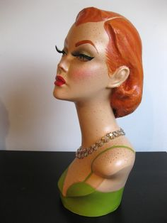 Pinup mannequin head jewelry hat display.