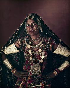 """Rabari tribe woman, India. For almoust  1.000 years, the people of the Rabari tribe have roamed the deserts and plains if what is today weastern India. Now found largely in Gujarat and Rajasthan, it is belived that they migrated from the Iranian plateau more than a millenium ago. Their name means """"outsider"""" and traditionally they were camel herders, crossing desert areas that were off- limits to other tribal groops."""