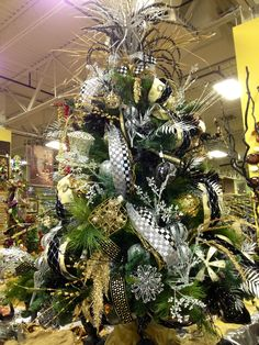 Gold, silver and black.  @jen Darwin Gold and silver look great together!!! #Christmas tree