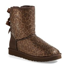 Women's UGG Australia 'Bailey Bow Glitter' Boot ($130) ❤ liked on Polyvore featuring shoes, boots, ankle booties, ugg australia boots, bow boots, shearling-lined boots, glitter shoes and glitter boots