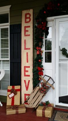 Christmas porch decor. I like the idea of having presents around the front door.