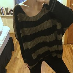 LF oversized striped sweater in black brown Black brown sweater with front pocket and oversized fit. Off the shoulder or boat neck style. Large knit and barely worn. No defects that I am aware of. Tag says S/M by Katsumi and sold at LF. MOVING SALE- buy at this price before Sunday. LF Sweaters Crew & Scoop Necks