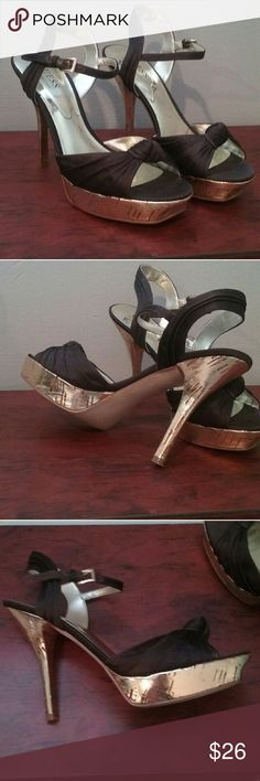 Guess heels Like New! Gorgeous gold and brown heels by Guess. Too small for me but look so cute on, pictures just don't do justice. The material is silky brown and the cork-type soles are shiny gold. No nics or scratches. Guess by Marciano Shoes Heels