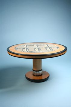 occasional-table-designed-by-piero-fornasetti.jpeg (900×1350)