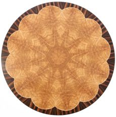 Sunburst Table Top This stunning table top shows a 12-piece bookmatched pattern of cerejeira with a border of Macassar ebony