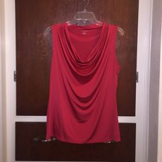 Silky sleeve less blouse Silky sleeve less blouse. Worthington brand. Size Large. Bright red color. The fabric is so silky and soft. It's perfect to dress up in or to wear to the office. 94% Polyester 6% Spandex Worthington Tops Blouses