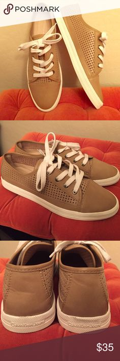 Calvin Klein Sneakers Authentic Calvin Klein Jeans Marigold Sneakers. Color: Tan. Perforated Design on the Sides, Center, and Flaps. Appears to be Leather. Does not indicate inside. White Shoe Laces. Brand New. Excellent Condition. No Trades. Calvin Klein Shoes Sneakers
