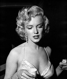 Marilyn Monroe preparing to attend the Children's Benefit at the Shrine Auditorium, Los Angeles. Photo by Phil Stern, December 4th 1953.