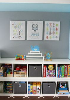 Thinking instead of stacking on top do both or only one with a seat cushion Cube shelving and cute prints on the wall :)