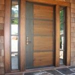 : Front doors for a mid century modern home have iron inserts