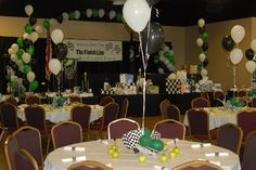This group alternated black and white table cloths and used black, white and green balloons to create a race theme. The centerpieces include checkered flags with the balloons along with green apples as a decoration/favor.