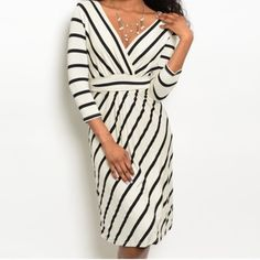 "Black and white striped dress This 3/4 length sleeve dress is beautiful, black and white stripes make this a classic. V-neck, tie around the waist. Brand new, retail, direct from the vendor, DOES NOT HAVE TAGS. S-M-L available. S:(L:40.5"", B:15"", S:17.5"") M:(L:41"", B:17"", S:17.5"") L:(L:41"",B:17.5"",S:17.5"") Does have stretch. Dresses"