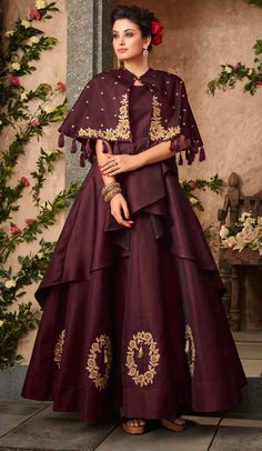 Vogue and trend could be at the peak of your beauty when you attire this Wine Color Satin Silk Party Wear Readymade Gown. this attractive dress is displayi Designer Gowns, Indian Designer Wear, Gown Party Wear, Gown With Jacket, Frocks And Gowns, Shrug For Dresses, Indian Gowns, Indian Party Wear Gowns, Pakistani Dresses