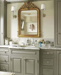 Love the cabinet color Maison Luxe - Sophisticated master bathroom with gray walls, bathroom cabinets painted Benjamin Moore Rockport Gray, marble countertop, Barbara Barry Small Simple Scallop Pendant, Thomas O'Brien Bryant Sconces flanking gilt mirror. Gray Bathroom Walls, Painting Bathroom Cabinets, Grey Walls, Master Bathroom, White Bathroom, Mirror Bathroom, Bathroom Colors, Small Bathroom, 1950s Bathroom
