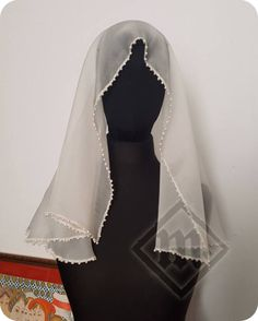 Very thin transparent 100% silk D-shaped veil decorated with 242(!) river pearls on the edges. Could be worn with many hairstyles and headdresses between 14th and beginning of 15th century. All edges hand-stitched with a silk thread.  Dimensions: Width: 90cm Lenght: 70cm