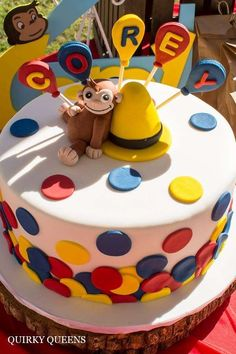 Colorful cake at a Curious George birthday party! See more party planning ideas at CatchMyParty.com!