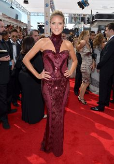 """Celebs Wearing Marsala, The 2015 Pantone Color Of The Year: Heidi Klum's """"Project Runway"""" co-star Tim Gunn described the color of her 2013 Emmys dress as """"pomegranate,"""" but we think the high-necked Atelier Versace creation could also easily be called marsala."""