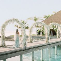 """During this three-day celebration in the Maldives, the bride walked through arches of baby's breath, silk wisteria, and orchids on a footbridge over a crystal-clear lagoon to get to the ceremony in a waterfront pavilion. """"I felt like I was floating,"""" she recalls. To see more of this destination wedding weekend, pick up our new special issue! : @ktmerry   @peonyt @itsrichardlim   @COMOHotels @lelianchew @thelovells @oscardelarenta #marthaweddings"""
